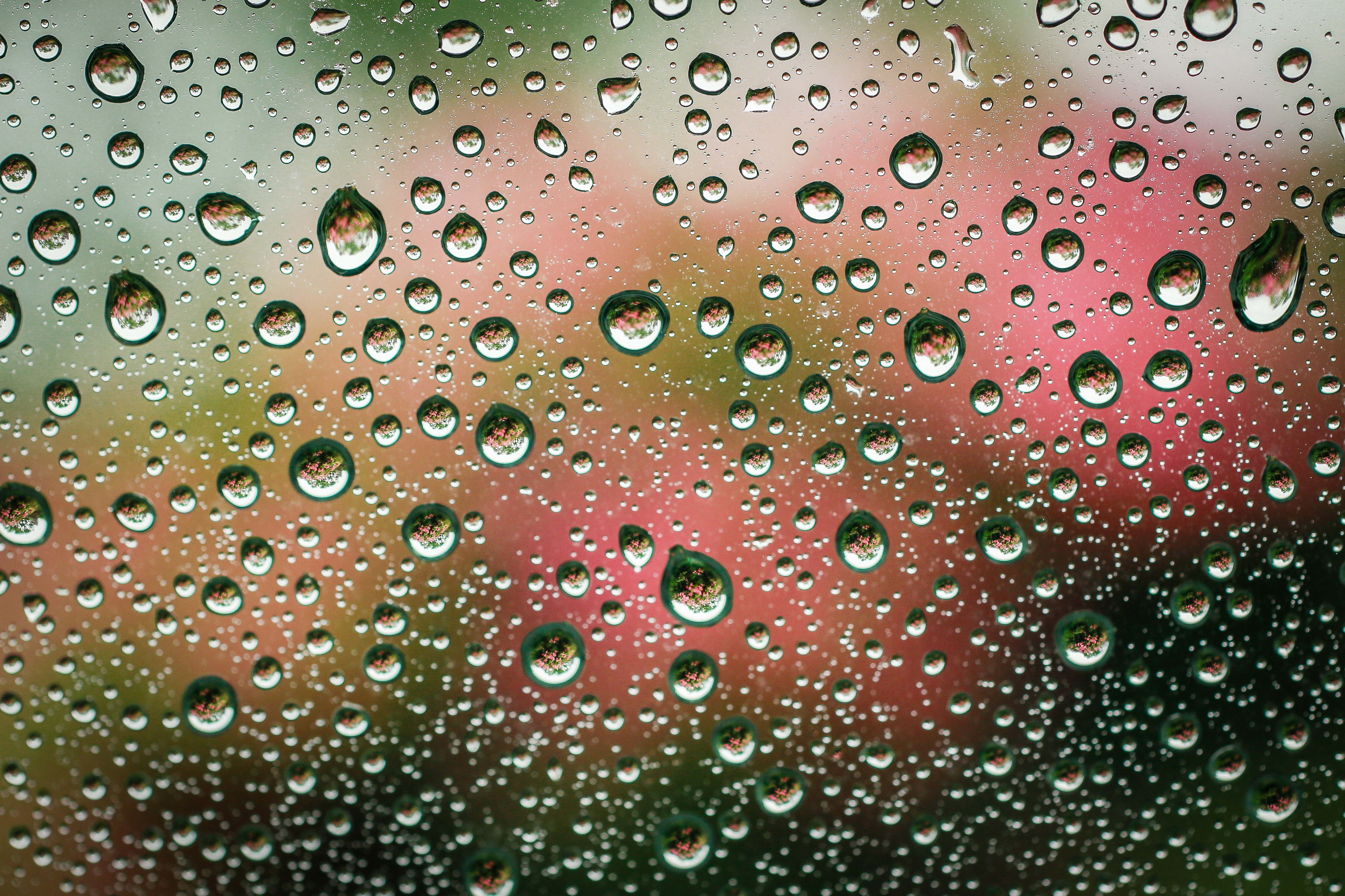Seeing and feeling water drops on glass.